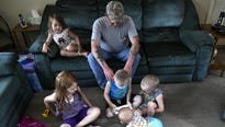 "John Lake and his fiancee are raising his five grandchildren. ""It's my family,"" John said. ""I'd do anything for them."""