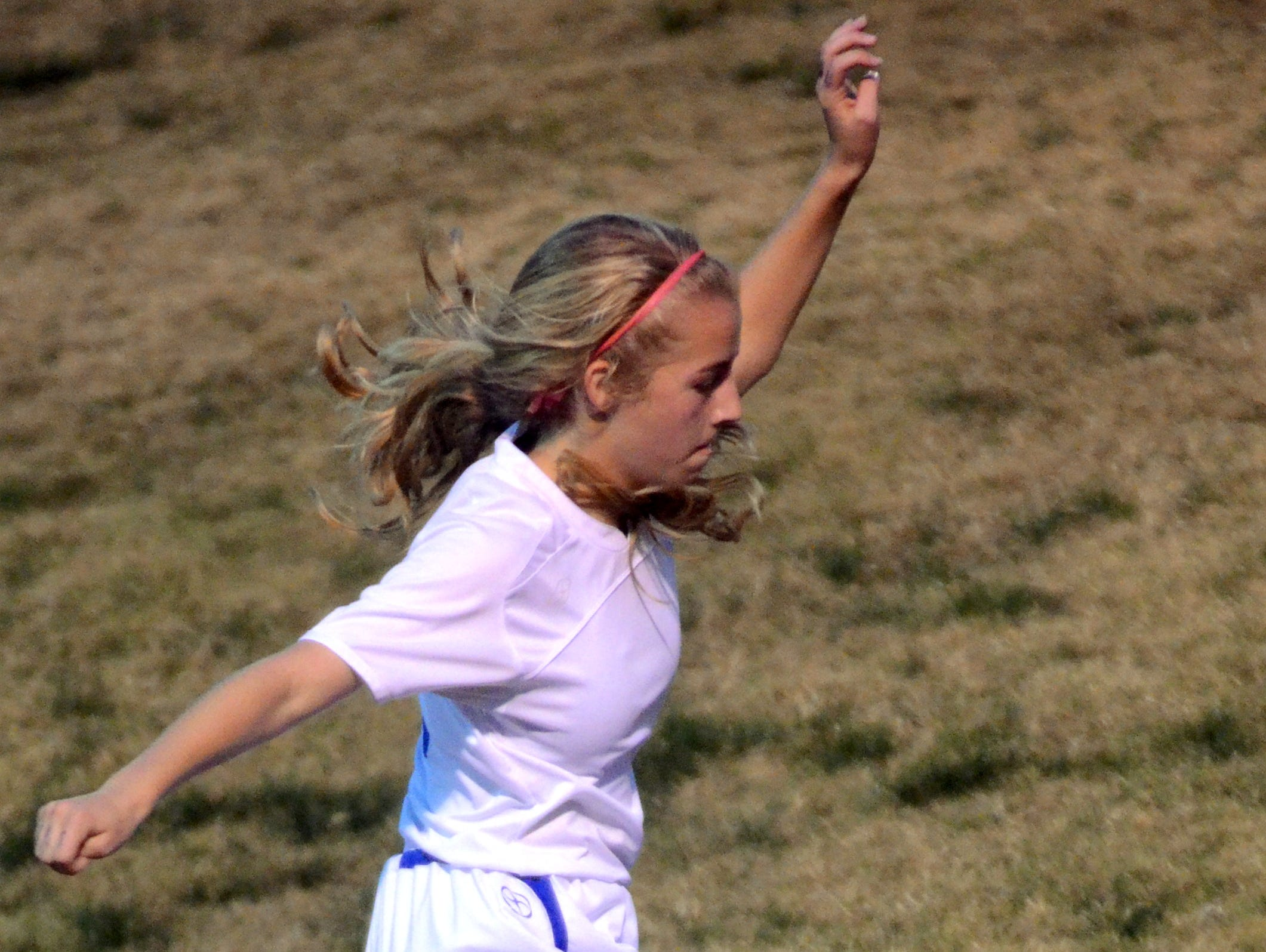 White House High freshman midfielder Mazie Burrow maneuvers along the sideline during second-half action.