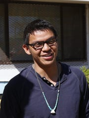 """Shiprock resident Graham Biyáál, a founding member of the Northern Diné Youth Committee, stands in front of the Healing Circle Drop-In Center in Shiprock on Wednesday. The group's story is the focus of """"Mayors of Shiprock"""" and the first committee meeting was held at the center in April 2010."""