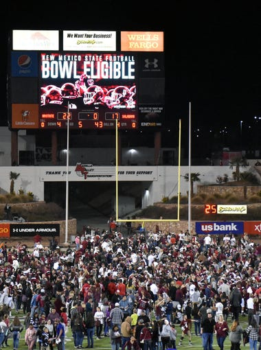 Fans rushed onto the field after the Aggies won and the scoreboard says it all.