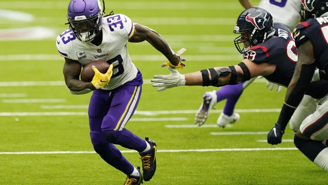 Minnesota Vikings running back Dalvin Cook breaks away from Houston Texans defensive end J.J. Watt during the Vikings' 31-23 win Sunday in Houston. Cook ran for 130 yards and two touchdowns to help Minnesota pick up its first win of the season.