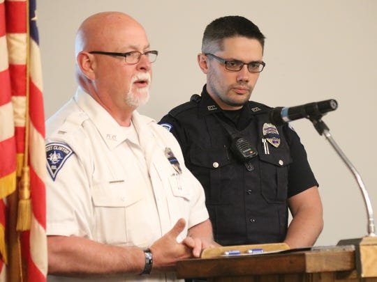 Port Clinton Police Chief Rob Hickman presents Patrolman Nathan Edmonds with his award as the 2018 Officer of the Year.
