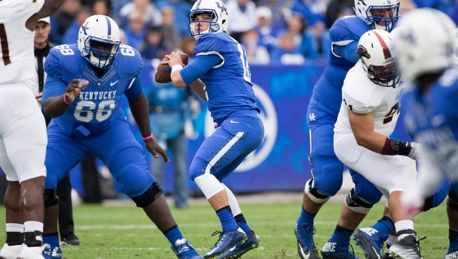 Kentucky quarterback Reese Phillips looks for a receiver during the second half of an NCAA college football game against Louisiana Monroe at Commonwealth Stadium in Lexington, Ky., Saturday, Oct. 11, 2014. Kentucky won the game 48-14. (AP Photo/David Stephenson)
