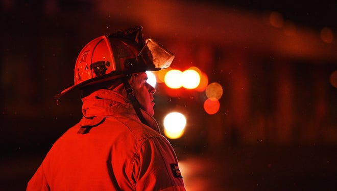 Firefighters with Sioux Falls Fire Rescue work the scene of a structure fire at the downtown Avera IT Building early Saturday morning, March 19, 2016, at the corner of 11th Street and Second Avenue in downtown Sioux Falls.