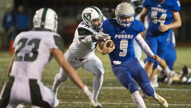 Poudre High School quarterback James Campbell tries to evade Fossil Ridge in 2015.