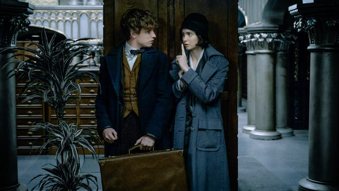 Newt (Eddie Redmayne) and Tina (Katherine Waterston) are fugitives on a mission in 'Fantastic Beasts and Where to Find Them.'