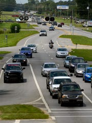 Traffic moves east on Nine Mile Rd. near Hwy. 29. In Sept. the Florida Department of transportation will begin at two-year, $46 million project of widening Nine Mile Road from two to four lanes.