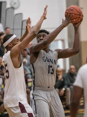Daijon Parker (13) of the Rockets, guarded by UDJ's