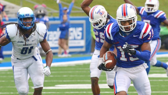 Louisiana Tech cornerback Bryson Abraham (15) returns an interception for a touchdown on Saturday against Middle Tennessee.