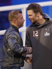 Los Angeles Rams head coach Sean McVay, left, greets Patriots quarterback Tom Brady on Monday in Atlanta.
