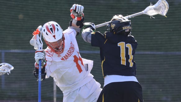 Mamaroneck's Max Vicinelli, left, collides with Lakeland/Panas'