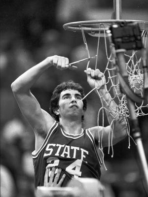 This 1983 photo shows North Carolina State's Terry Gannon helping cut down the nets following the Wolfpack's ACC Tournament Championship game in Atlanta, Ga. Gannon, in town to do play-by-play for the Golf Channel, shared his memories of what it was like to be on that NCAA championship team.