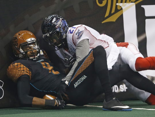Rattlers receiver Markee White (left) can't make a