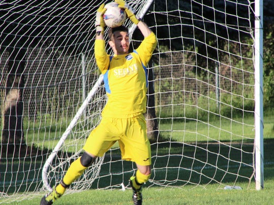 Milford's Beau Prey makes the save during a recent NPSL game for Kalamazoo FC.