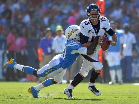 Chris McCain (40) shown here sacking and forcing a fumble on Denver Broncos quarterback Trevor Siemian.