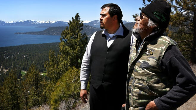 Washoe Tribe of Nevada and California Chairman Neil Mortimer, left, and tribal elder Elden Christensen look out over the Tahoe Basin and the Incline Village area from a pull out on the Mt. Rose Highway on April 27, 2018.