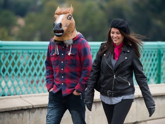 Jill Bruce and Parker Fulton cross Gay St. Bridge during Horse Bike Walk Knoxville's Open Streets on Sunday, October 29, 2017.