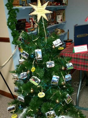 The Town Hall's Christmas Tree at the museum is decorated with Webster photos, and blue and gold trim. (Provided photo)