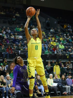 Oregon's Satou Sabally shoots over Weber State defender Larryn Brooks during an NCAA college basketball game in Eugene, Ore., Saturday, Dec. 2, 2017.