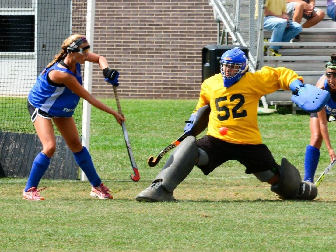 Sarah Dwyer (52) makes a save during a game for Shore.