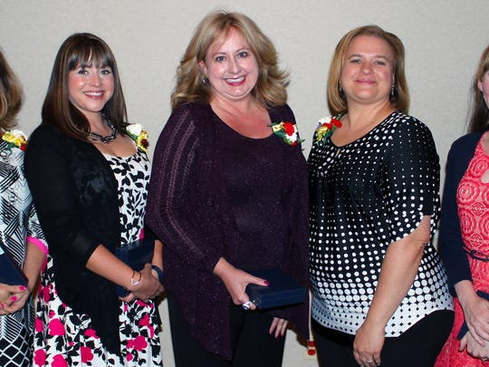 The 2017 Las Cruces Public Schools' Teacher of the Year is Cheryl Carreon (center) who is a  developmentally delayed preschool teacher from East Picacho Elementary School.  The other finalists are (left to right): 4th Runner-Up, Debra Vance, Picacho Middle School; 3rd Runner-Up, Tiffany Valles, Sierra Middle School; Carreon; 2nd Runner-Up, Tamara Miller-Dwake, Arrowhead Park Early College High School; and 1st Runner-Up, Melody Hagaman, Centennial High School.
