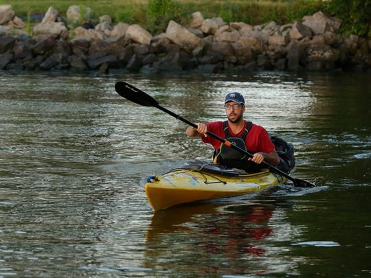 Justin McArthur of Fond du Lac makes is way out of Asylum Bay kayaking on day two of his four day journey around Lake Winnebago, Tuesday, August 29, 2017.  McArthur is doing it as a personal goal for Paddle Everything as well as for Camp to Belong that reunites siblings in the foster care system that maybe separated.
