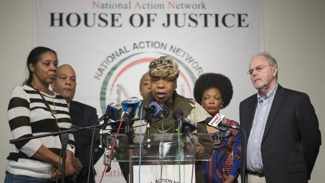Gwen Carr, center, Eric Garner's mother, and Esaw Garner, left, Garner's widow, attend a press conference denouncing the shooting deaths of two New York Police Department (NYPD) officers at the National Action Network on Sunday in Harlem.