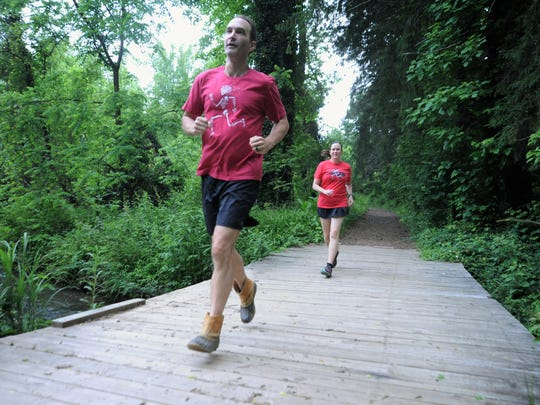 Sam and Julia Moore run on the trails that make up the course of the Black Mountain Monster, which they will both run for the first time on Saturday, June 2.