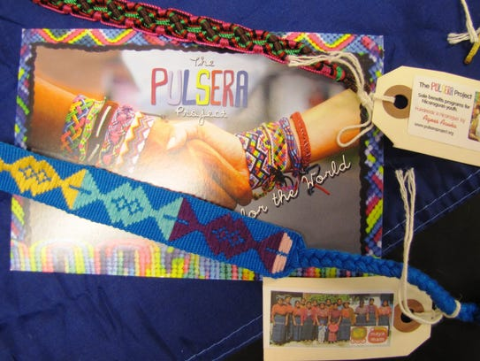 Woven bracelets sold through The Pulsera Project include