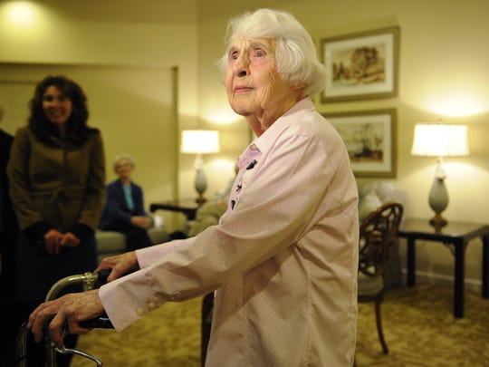 Ruth Hessey, 95, talks with members of the media after walking with Mayor Karl Dean at her apartment building at St. Paul Senior Living Community Thursday, Jan. 24, 2013 in Nashville, TN.