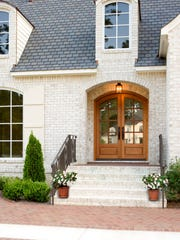 A custom wood entry door, such as this JELD-WEN Spanish