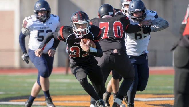 Newark Valley sophomore Caden Bennett runs through a huge hole against Skaneateles.