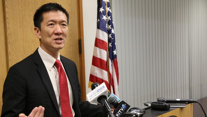Hawaii Attorney General Douglas Chin speaks at a news conference in Honolulu.