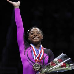 Simone Biles competes on the balance beam at the 2014 P&G Championships at the CONSOL Energy Center.
