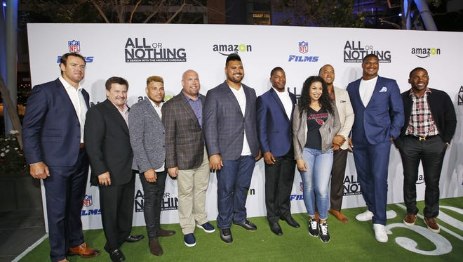 Arizona Cardinals quarterback Carson Palmer (from left), team President Michael Bidwill, Tyrann Mathieu, GM Steve Keim, Mike Iupati, David Johnson, singer Jordin Sparks, Michael Floyd, Calais Campbell and Patrick Peterson at the LA premiere.