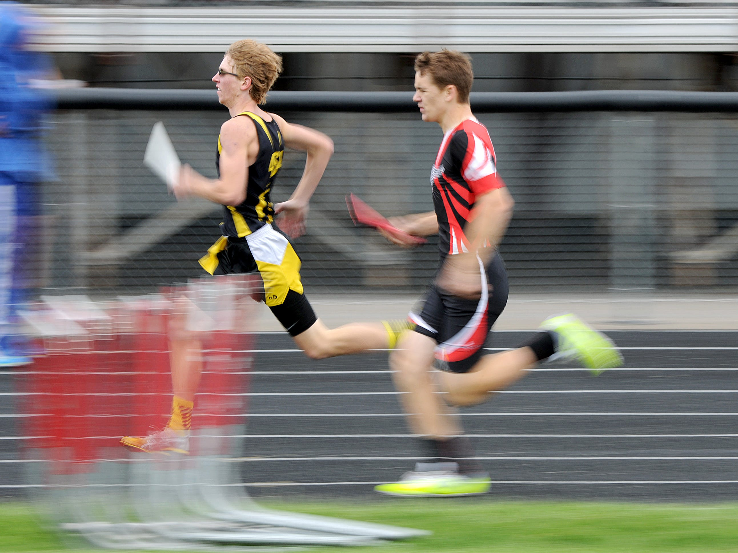 Colonel Crawford's Brad Bauer and Crestview's Noah Shriver of Crestview sprint to the finish during their leg of the boys 4 x 800 meter relay in Thursday's Division III district track meet at Bucyrus. Crawford won the race and Crestview took second