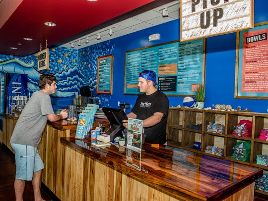 Surf Taco's coastal cuisine menu features tacos, burritos,