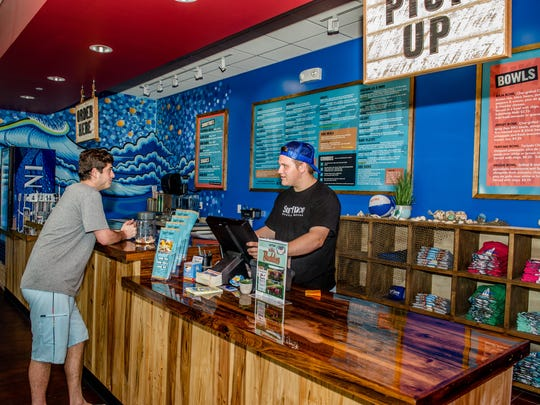 Surf Taco's coastal cuisine menu features tacos, burritos,