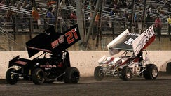 Sprint cars are shown competing at Texas Motor Speedway