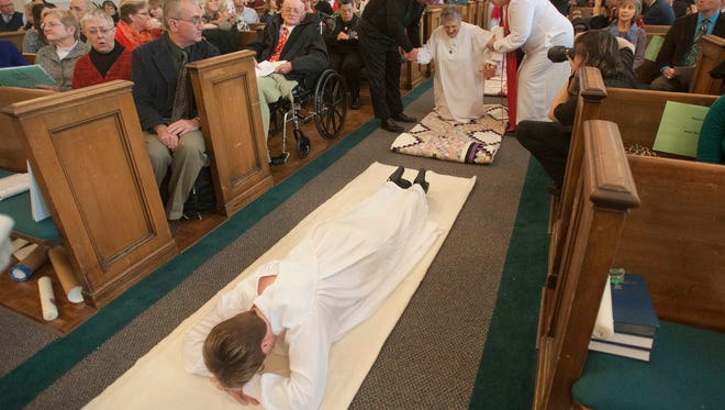 Five Roman Catholic women were ordained -- four as deacons and one as a priest -- at  Central Presbyterian Church in Louisville, Ky., by the Association of Roman Catholic Women Priests on Sunday, Dec. 8, 2013. As priest candidate Mary Sue Barnett lay prostrate in the aisle, deacon candidate Betty H. Smith got some help getting into position.