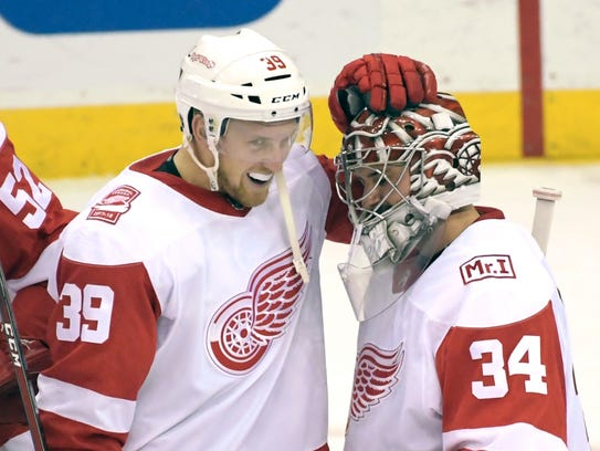 Red Wings right wing Anthony Mantha (39) and goaltender
