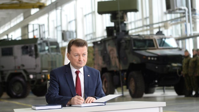 Polish Defense Minister Mariusz Blaszczak signs a deal to buy the U.S. made air defense Patriot system in Warsaw, Poland, on March 28, 2018.
