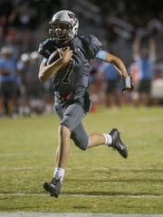 Rancho Mirage quarterback David Talley scampers across