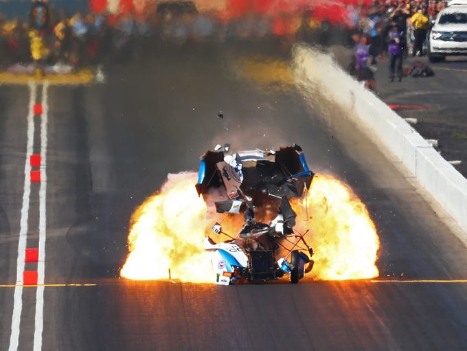 NHRA driver John Force's funny car explodes into flames