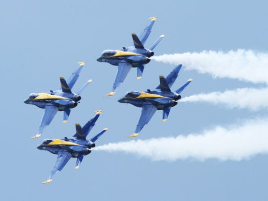Navy Blue Angel F/A 18 Hornets fly in formation during