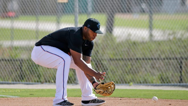 Miami Marlins infielder Jesus Aguilar runs a drill at spring training baseball camp in Jupiter, Fla., Wednesday, Feb. 12, 2020. (David Santiago/Miami Herald via AP)