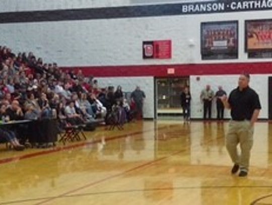Ozark Middle School Principal Jim Hubbard tells students,