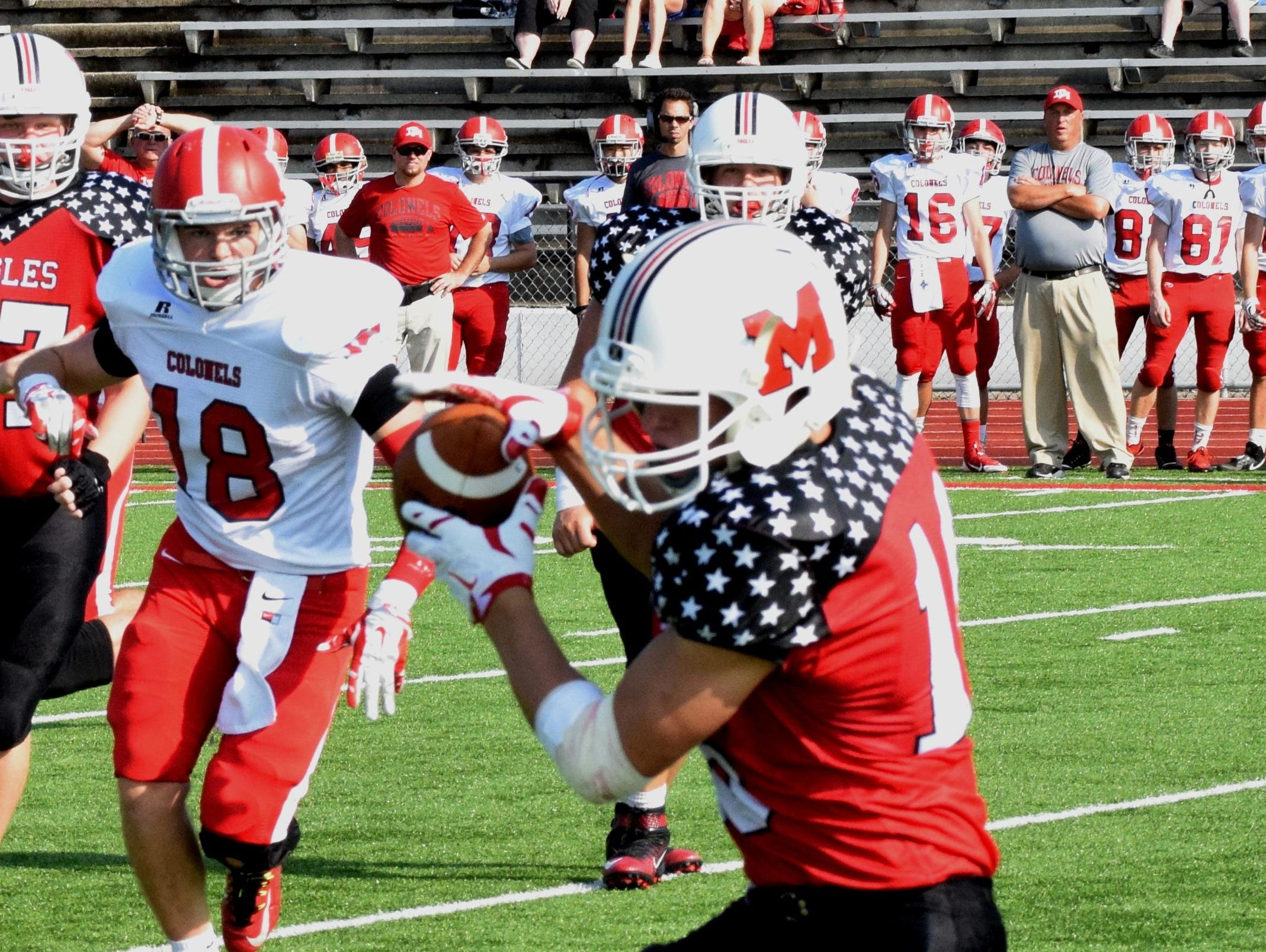 Milford's Ben Greenwell pulls in a pass against Dixie Heights.