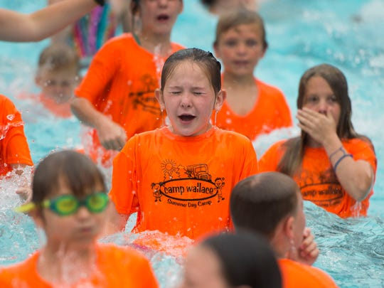Children from Camp Wallace in Knoxville practice fully submerging under water at a giant swim lesson held by Dollywood's Splash Country in its wave pool at its annual water safety day Thursday, June 21, 2018.