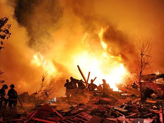 Firefighters are shown battling the fires that engulfed the Richmond Hill neighborhood on the night of Nov. 10, 2012.